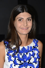 Giovanna Battaglia opted for simple styling with this loose center-parted 'do when she attended the Chanel Fine Jewelry 80th anniversary celebration.