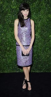 Caroline Sieber walked on the wild side in a purple leopard-print leather dress by Christopher Kane during the London Evening Standard Theatre Awards.