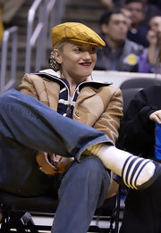 Gwen Stefani watched an NBA game looking cool in a yellow ivy cap.