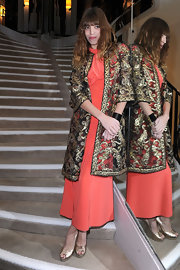 Lou Doillon kept it classy in a lacy evening coat layered over a coral dress during the Chanel dinner in honor of Blake Lively.