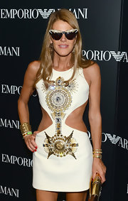 Anna dello Russo topped off her fab ensemble with a luxurious gold bracelet watch by Bulgari.