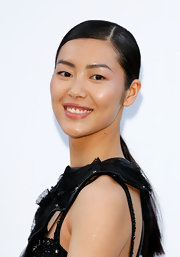 Liu Wen opted for a simple side-parted ponytail when she attended the amfAR Cinema Against AIDS Gala.