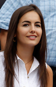 Camilla Belle wore her hair down in a stylish layered cut while watching the U.S. Open.