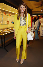 Anna dello Russo brought a bright vibe to the Manolo Blahnik collection preview with this smart yellow pantsuit.