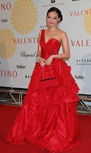 Shu Qi had a princess moment in this one-shoulder billowing red gown with ruffled tiered layers  at the Valentino 45th Anniversary Celebration.