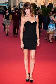 Lou Doillon showed off her slim and sexy physique in a tiny strapless LBD by Saint Laurent during the premiere of 'Blue Jasmine.'