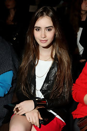 Lily Collins attended the Lacoste fashion show rocking a huge gemstone ring.