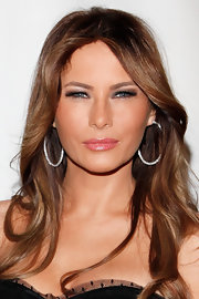 For a bit of sparkle, Melania Trump accessorized with a pair of diamond hoops.
