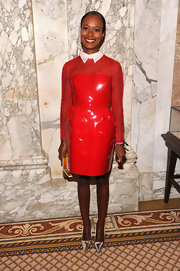 Shala Monroque shimmered at the amfAR Inspiration Gala in a red Valentino patent leather dress with sheer sleeves and a white collar.