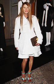 This simple white skirt suit was a surprising choice for Anna dello Russo, who's know for her eccentric style.