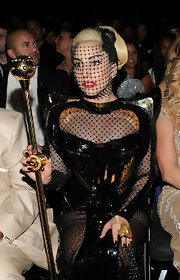 Lady Gaga attended the Grammys looking perfectly coordinated in black and gold, all the way down to her nails!