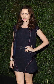 Lily Collins styled her casual outfit with a lovely filigree cuff bracelet, also by Chanel.