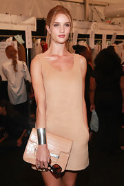 Rosie Huntington-Whiteley dressed up her simple monochromatic outfit with a thick gold cuff bracelet for the Michael Kors fashion show.