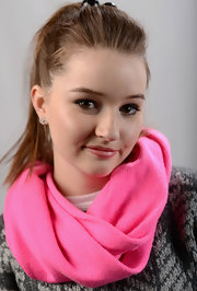 Kaitlyn Dever brightened up her outfit with a hot-pink scarf.
