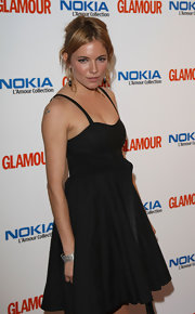 Sienna Miller spruced up her simple black dress with a gorgeous diamond bracelet for the Glamour Women of the Year Awards.