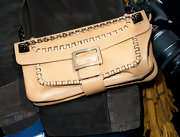 Ines de la Fressange carried a nude leather crossbody purse to the Dior fashion show at Paris Fashion Week 2012.