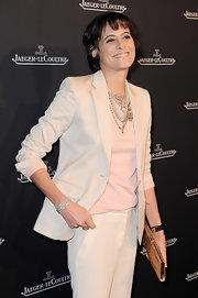 Ines de la Fressange layered pearl and chain necklaces to style her outfit at the Jaeger-LeCoultre boutique launch.