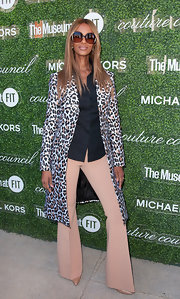 Iman teamed flared beige pants with a leopard-print coat for a fiercely stylish look during the Couture Council Fashion Visionary Awards.