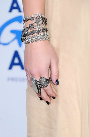 Miley Cyrus added a gothic touch with some dark nail polish.