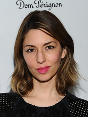 Sofia Coppola added a dose of sweetness with a swipe of pink lipstick.