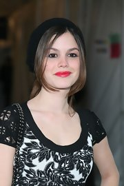 Rachel Bilson's red lipstick added a spot of brightness to her monochrome outfit.