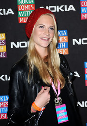 Poppy Delevingne tamed her locks with a cute red knit beanie when she attended the Nokia Comes with Music launch.