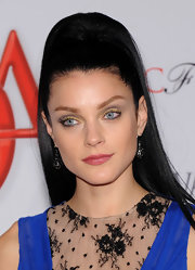 Jessica Stam completed her colorful look with a swipe of pink lipstick.