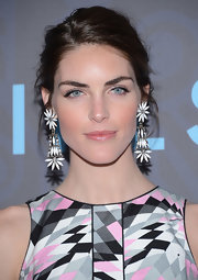 Hilary Rhoda made an ultra-feminine statement with these whimsical flower chandelier earrings.