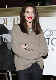 Hilary Rhoda attended the DuJour Magazine gala wearing a classic gold quartz watch.