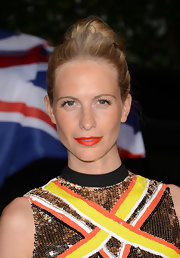 Poppy Delevingne rocked bright orange lips for the Topshop Topman LA Opening Party.
