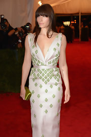 Jessica Biel attended the Met Gala carrying a green Prada satin clutch that matched the embellishments on her dress.