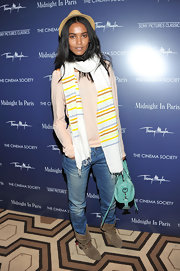 Liya Kebede styled her casual getup with a striped scarf.
