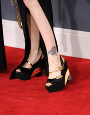 Cyndi Lauper attended the 54th Grammy Awards wearing a thigh-high slit skirt showing off her fork wedges.