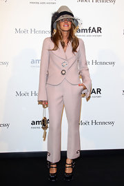 Anna dello Russo chose a loose-fit lilac pantsuit by Louis Vuitton for the amfAR Milano Gala.