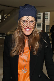 Anna dello Russo added more sparkle with a lovely diamond pendant necklace.