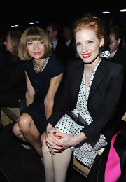 Jessica Chastain sat front row at the Saint Laurent fashion show sporting matching red nails and lipstick.