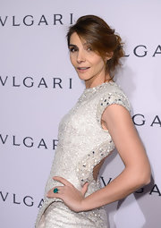 Clotilde Courau's emerald ring added a welcome pop of color to her neutral outfit at the Bulgari event.