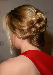 Dakota Johnson styled her hair into a loose, messy bun for the Heaven Gala.