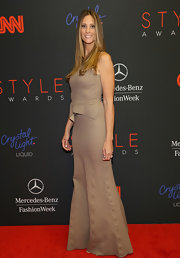 Stephanie Winston Wolkoff kept it simple in a sleeveless tan peplum dress at the Style Awards.