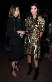Carine Roitfeld attended the Hermes fashion show carrying a small black satchel.