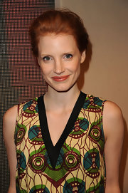 Jessica Chastain swept her hair up into a loose bun for the Marni at H&M collection launch.
