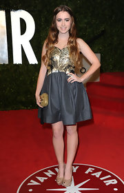 A gemstone-inlaid clutch by Raven Kauffman Couture finished off Lily Collins' red carpet look.