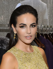 Camilla Belle wore her long hair loose and slicked back from her face when she attended the Kors Collaborations event.