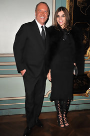 Carine Roitfeld wore her outfit with a pair of black open-toe lace-up boots for a fancier finish.