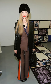 Joanna Hillman matched a black leather-sleeve coat with a retro pantsuit for the Brood fashion show.