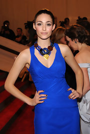 A chunky, multicolored statement necklace added some boldness to Emmy Rossum's Met Gala look.