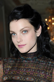 Jessica Stam pulled her dark locks back into a half-up, wavy style for the Valentino fashion show.