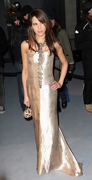 Caroline Sieber complemented her beautiful gown with a nude chain-strap bag.