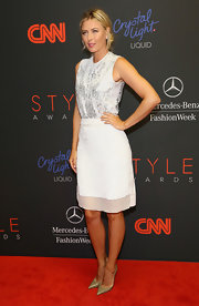 Maria Sharapova hit the Style Awards red carpet wearing a white knee-length skirt and an embellished blouse by Preen.