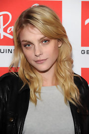 It would take more than a simple wavy hairstyle and a makeup-free face to make Jessica Stam look less than gorgeous!
